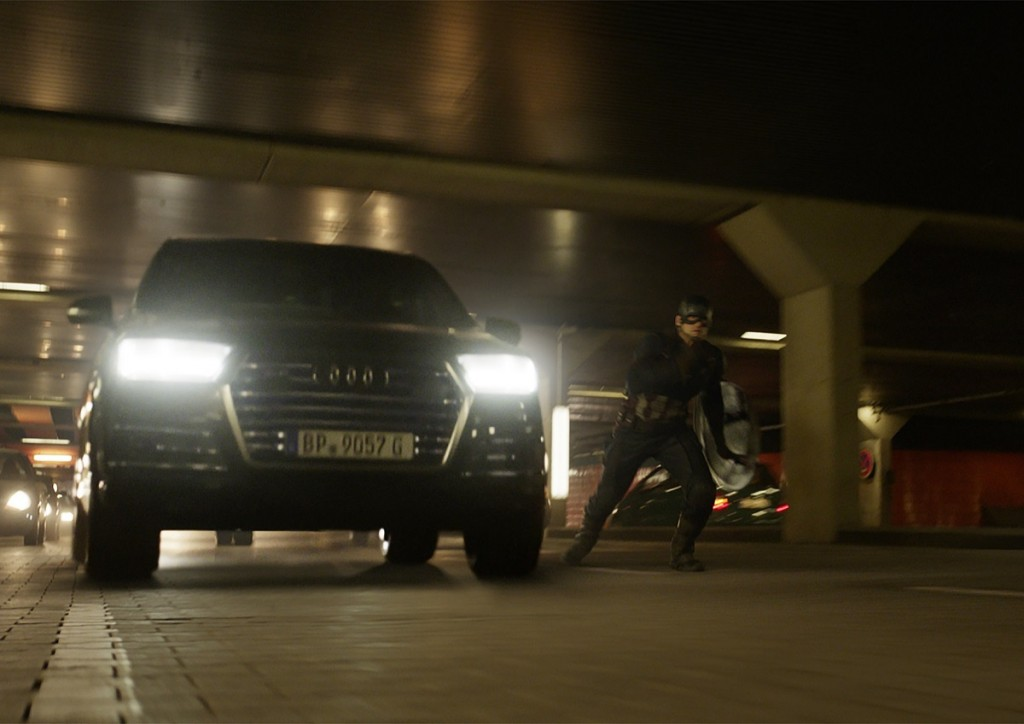 Captain America (Chris Evans) besides an Audi SQ7.